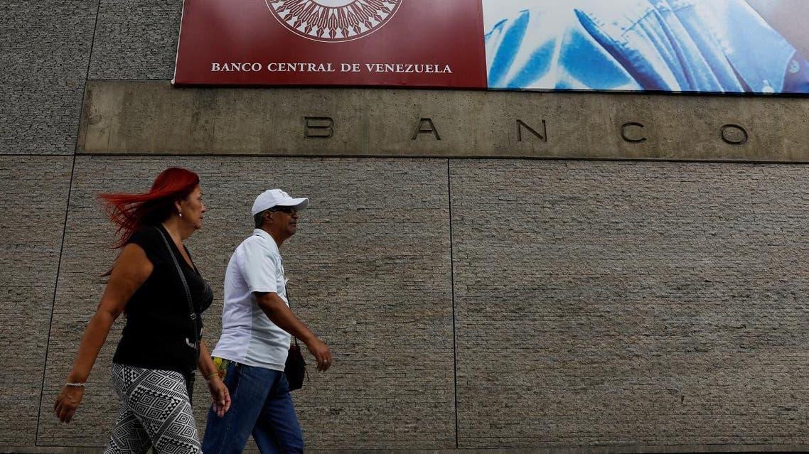 People walk outside of Venezuela's Central Bank in Caracas. (Reuters)