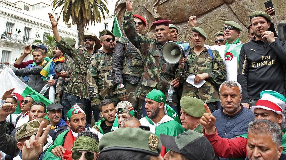 Algerian military veterans chant slogans as they take part in an anti-government demonstration at Emir Abdelkader square in the capital Algiers on April 19, 2019. (AFP)