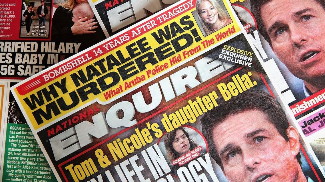 In this photo illustration, celebrity gossip dominates the cover of a National Enquirer magazine on April 11, 2019 in Chicago, Illinois. (AFP)