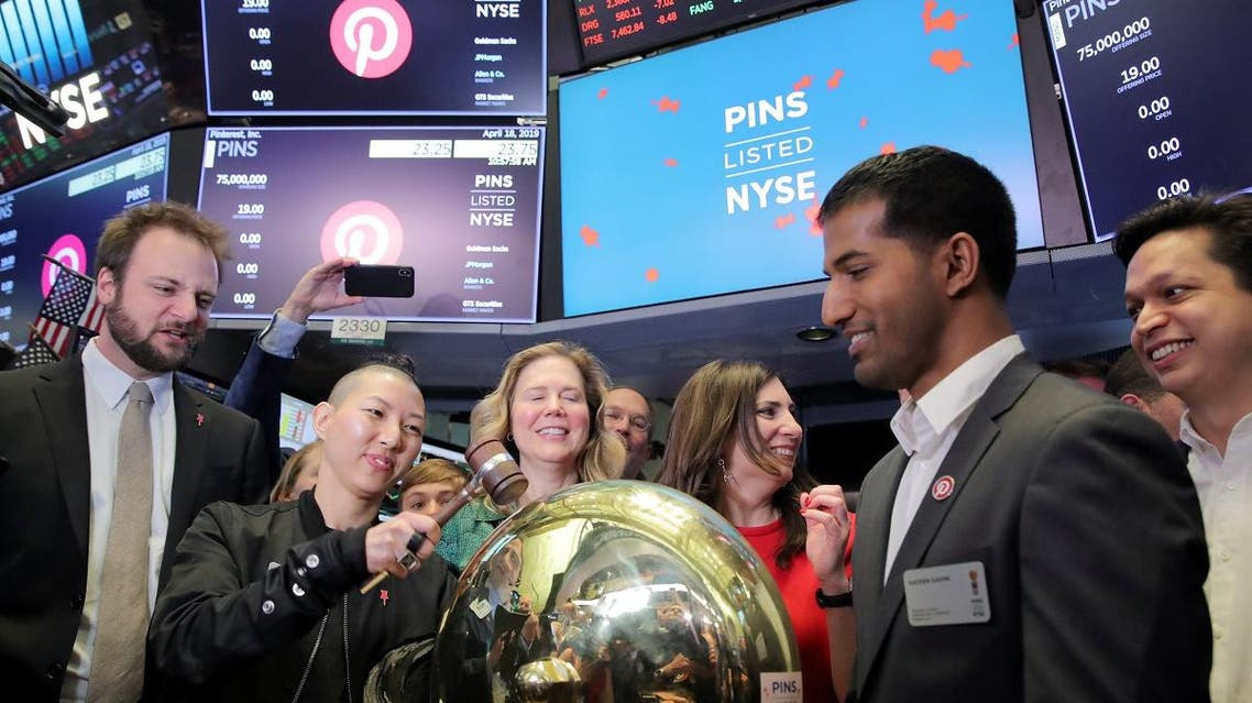 Pinterest, Inc. Community Manager Enid Hwang rings the opening bell at the IPO of Pinterest Inc. at the New York Stock Exchange in New York, on April 18, 2019. (Reuters)