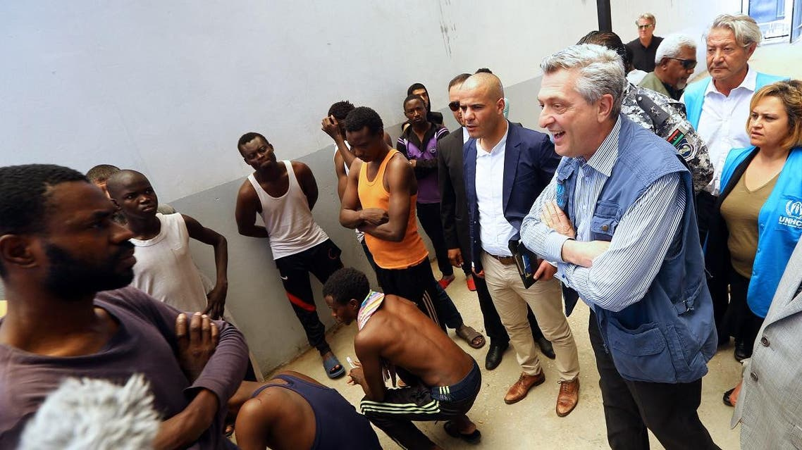 The United Nations' High Commissioner for Refugees (UNHCR) Filippo Grandi (R) speaks to illegal immigrants at the Tripoli branch of the Illegal Immigration Authority, in the Libyan capital on May 21, 2017. (AFP)