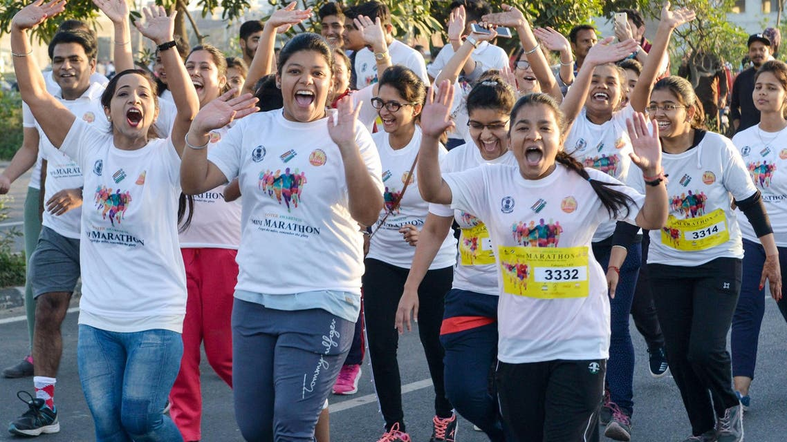 """Indian runners take part in a """"Voter Awareness Marathon"""" in Amritsar on March 31, 2019. (AFP)"""