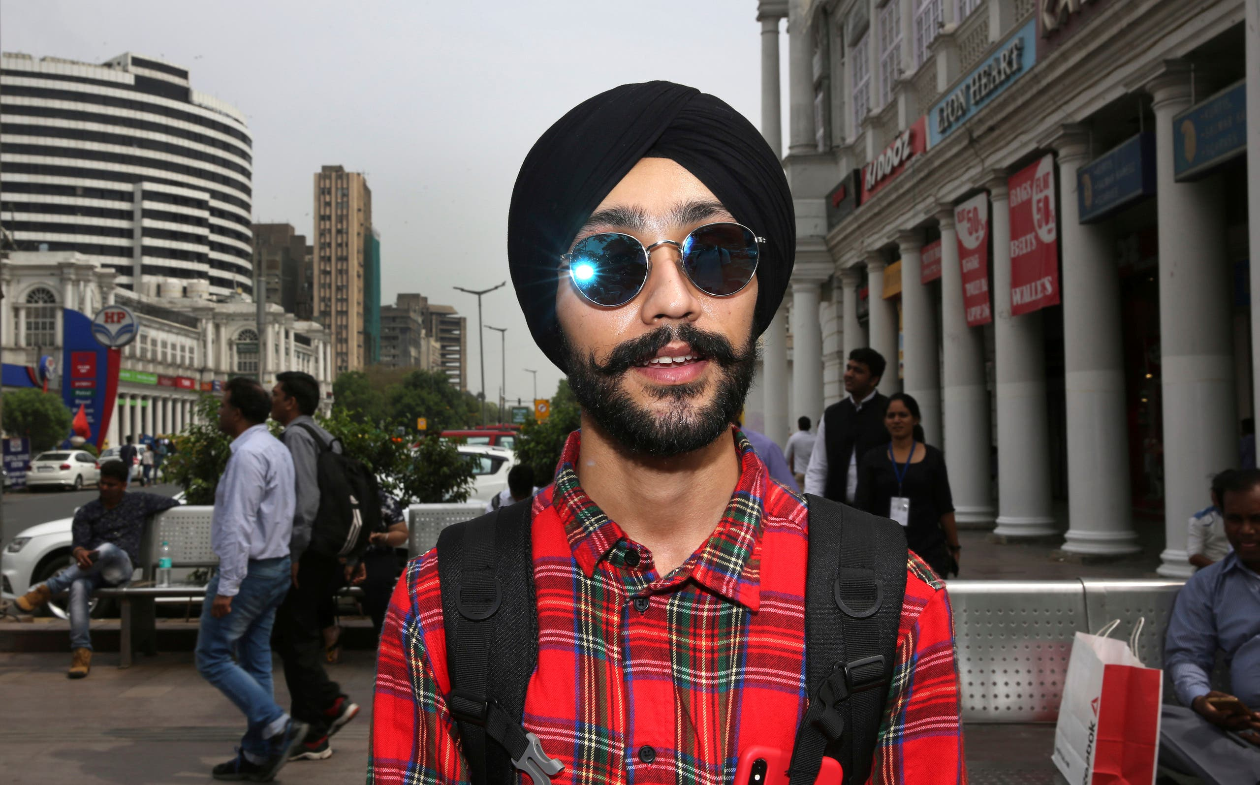 Rajanvir Singh Luthra, 23, a You Tube vlogger, stands for a photograph in New Delhi, India. (AP)