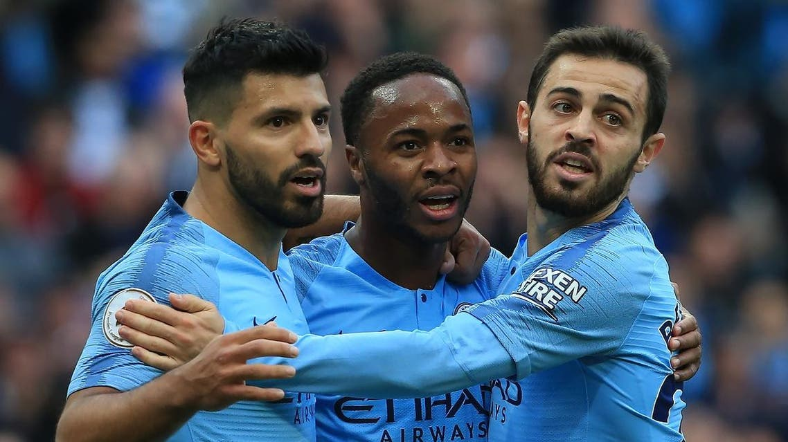 Manchester City's English midfielder Raheem Sterling (C) celebrates with Manchester City's Argentinian striker Sergio Aguero (L) and Manchester City's Portuguese midfielder Bernardo Silva after scoring the team's first goal during the English Premier League football match between Manchester City and Brighton and Hove Albion at the Etihad Stadium in Manchester, north west England, on September 29, 2018. (AFP)