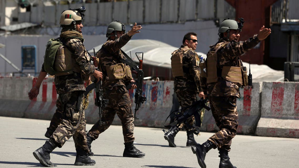 Afghan security personnel arrive at the site of an explosion in Kabul on March 13, 2017. (AFP)