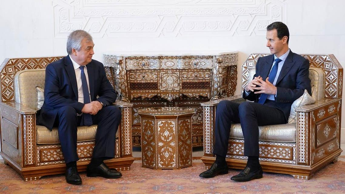 President Bashar al-Assad (R) meeting with Russia's special envoy on Syria Alexander Lavrentiev in Damascus. (AFP)