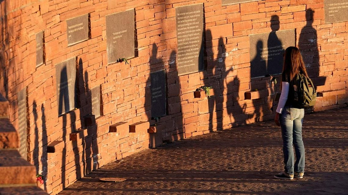 A visitor looks at the Columbine memorial a day before the school shooting's 20th anniversary, in Littleton, Colorado. (Reuters)
