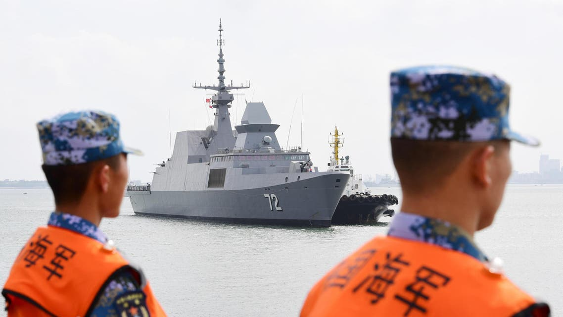 This photo taken on October 21, 2018 shows Chinese sailors watching as a navy ship arrives at a military port in Zhanjiang, in China's southern Guangdong province (AFP)