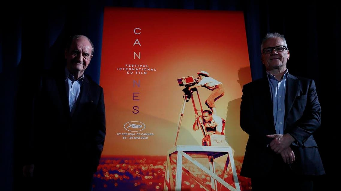 Festival director Thierry Fremaux, right, and festival president Pierre Lescure pose in front of the Cannes International Film Festival poster for the upcoming 72nd edition during a press conference. (AP)