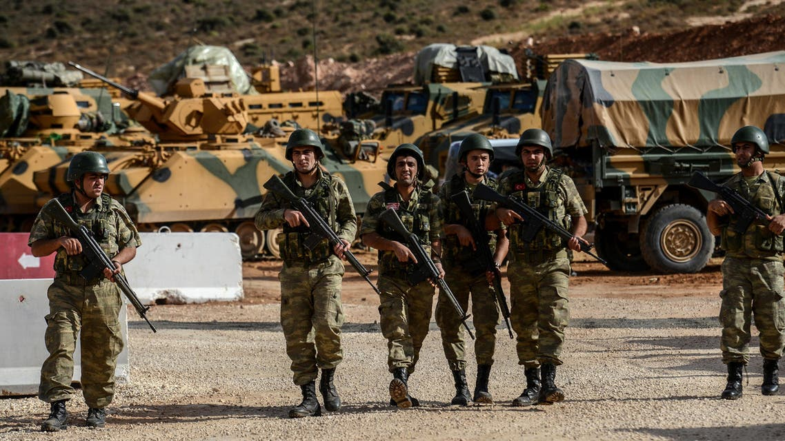 Turkish soldiers stand near armoured vehicles during a demonstration in support of the Turkish army's Idlib operation near the Turkey-Syria border near Reyhanli, Hatay, on October 10, 2017. (AFP)