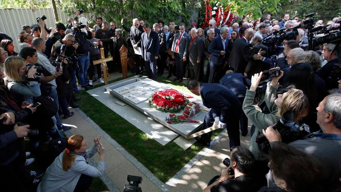 Workers place the stone onto the tomb of Mirjana Markovic, the widow of former strongman Slobodan Milosevic during her funeral at the yard of his estate in his home town of Pozarevac, Serbia. (AP)