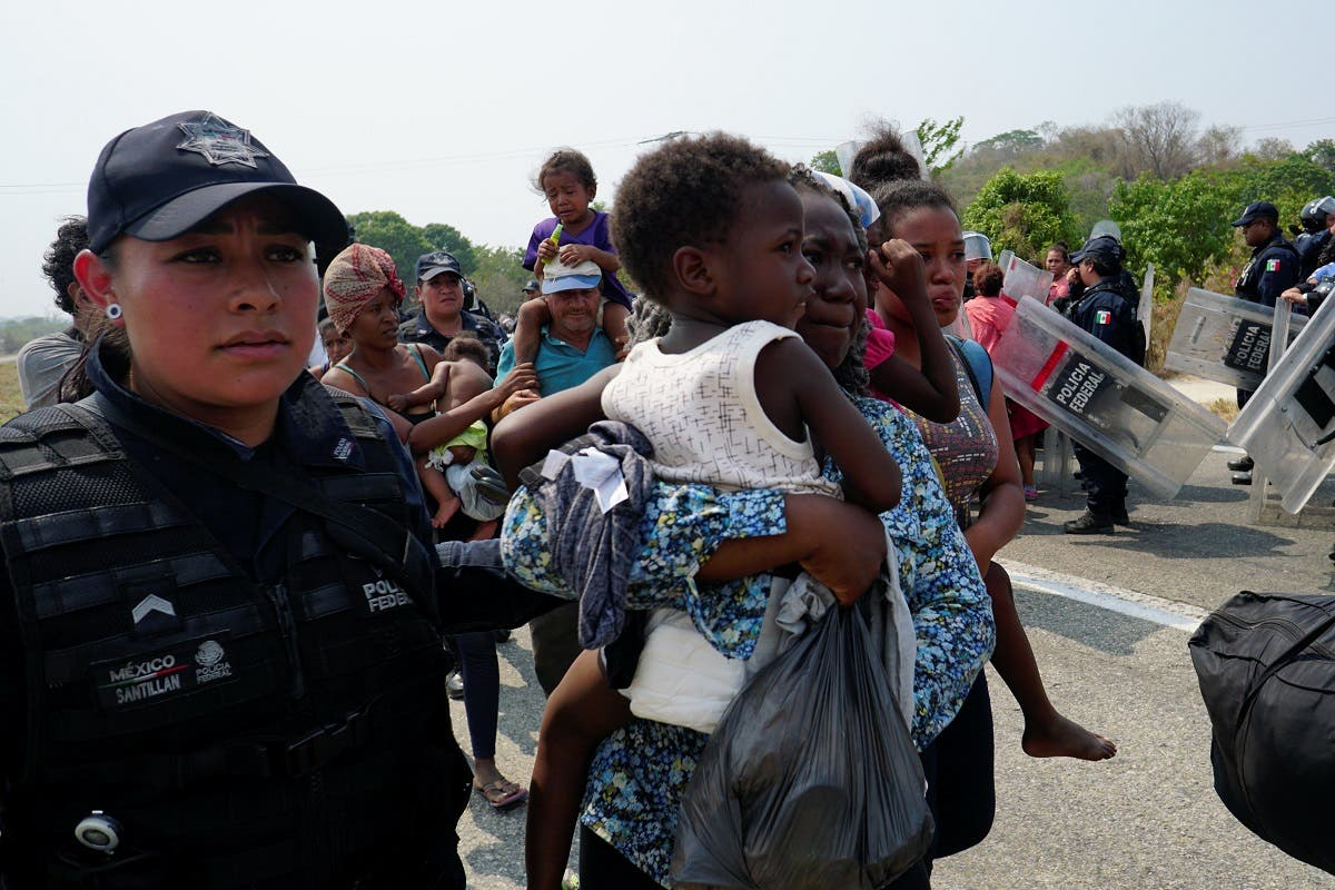 A Central American migrant is detained by a Federal Police officer in Mapastepec, Mexico. (Reuters)