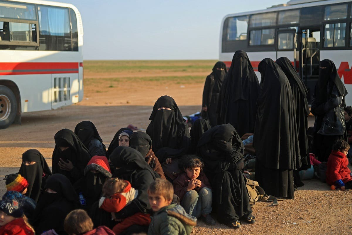 Women and children evacuated from ISISI last holdout of Baghouz wait to undergo security screening by US-backed Syrian Democratic Forces (SDF) fighters (not pictured) in Syria's northern Deir Ezzor province, on February 22, 2019. (AFP)