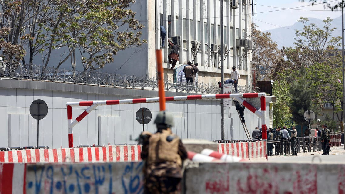 Afghan security personnel rescue men from the information and culture ministry after an attack near to the Telecommunication Ministry in Kabul, Afghanistan, Saturday, April 20, 2019. (AP)