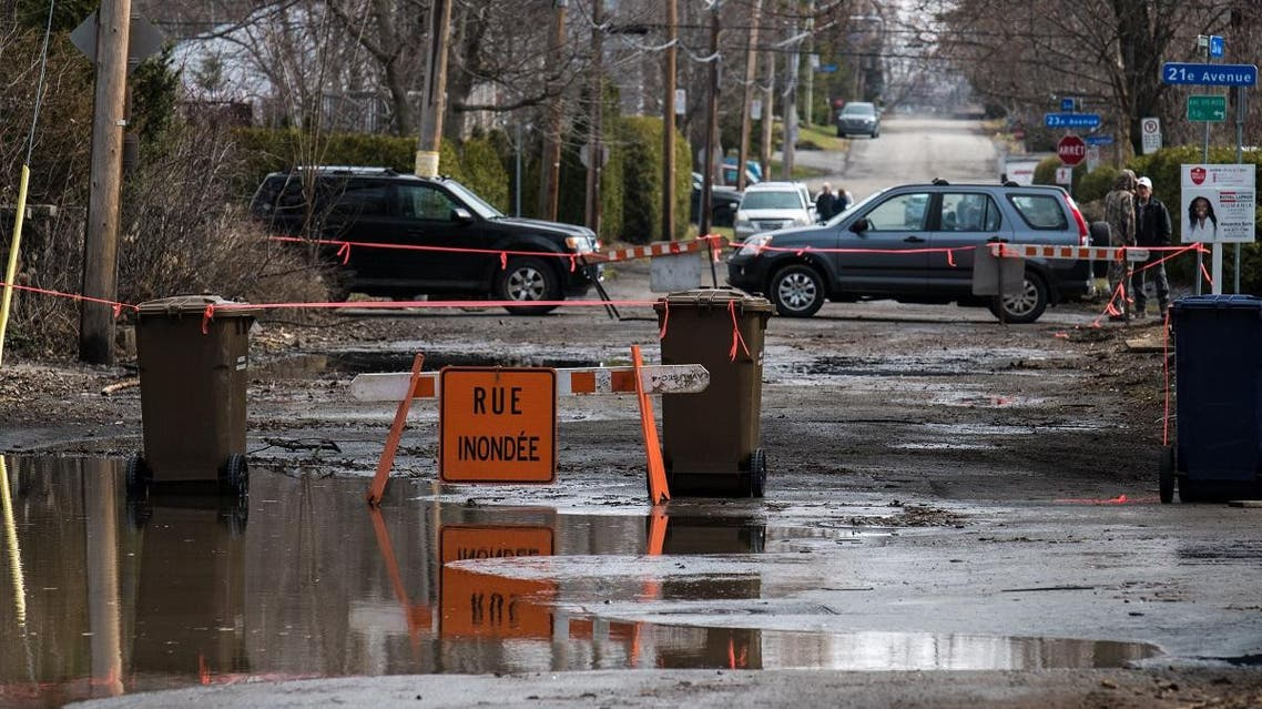 A closed road is seen on a flooded street in Laval, Canada. (AFP)