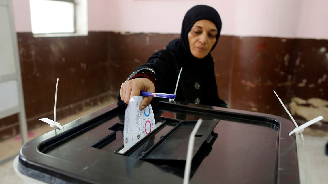 A voter casts her ballot on constitutional amendments during the first day of three-day voting at a polling station in Cairo, Egypt on April 20. (AP)