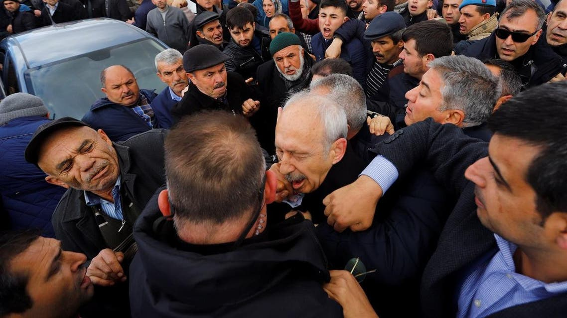 Kemal Kilicdaroglu, leader of the main opposition CHP, is attacked by a man during a funeral ceremony in Cubuk. (Reuters)
