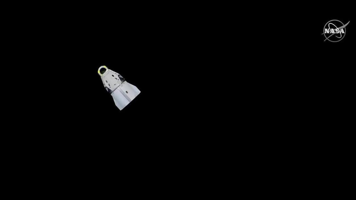 This still image taken from NASA TV, shows SpaceX'S Crew Dragon capsule after undocking from the International Space Station on March 8, 2019, in the Atlantic Ocean. The Dragon capsule completed its NASA demonstration mission Friday with a successful splashdown in the Atlantic Ocean, paving the way for the resumption of manned space flights from the US.