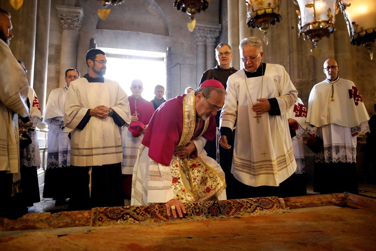Archbishop Pierbattista Pizzaballa, apostolic administrator of the Latin Patriarch of Jerusalem, attends the Sunday Easter Mass in the Church of the Holy Sepulchre in Jerusalem's Old City. (Reuters)