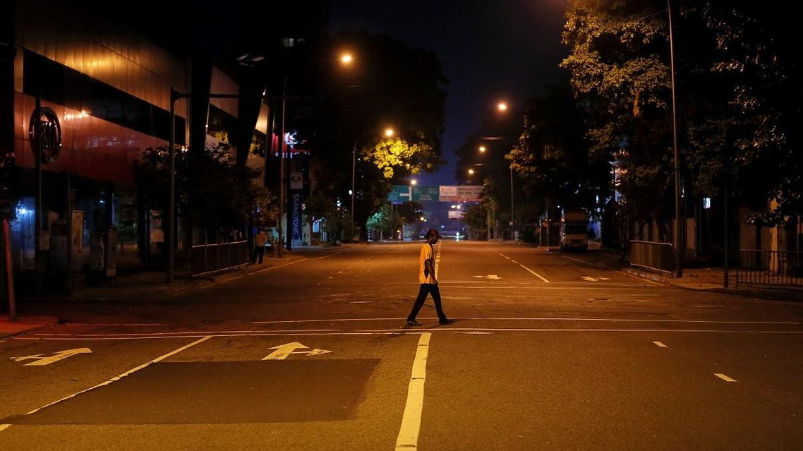 A man crosses a road during the curfew after multiple explosions in the country, in Colombo. (Reuters)