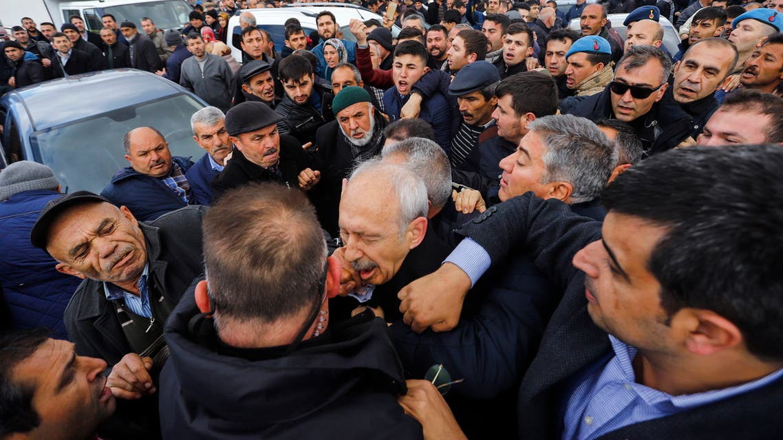 The Chairman of the Republican People's Party (CHP) Kemal Kilicdaroglu (C) is attacked by a protester on April 21, 2019 while attending a funeral ceremony in Ankara's Cubuk district for a soldier killed in fighting against Kurdish militants. The CHP last month won Ankara and Istanbul mayors' offices in local elections in a setback for President Recep Tayyip Erdogan's ruling party.