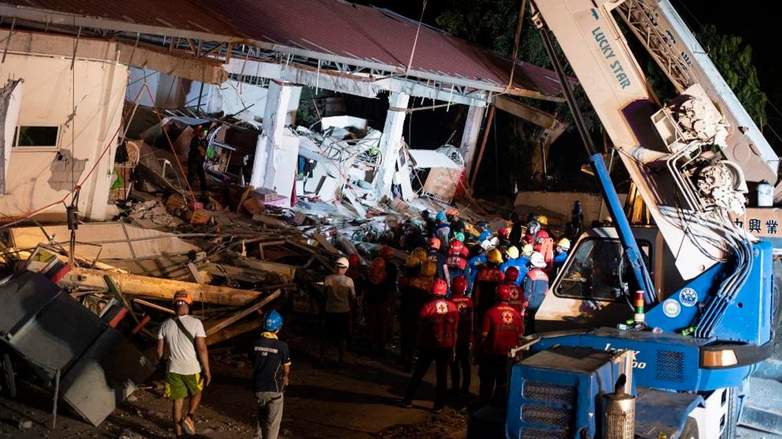 Rescue workers search for survivors in a collapsed Chuzon Super Market in Porac, Pampanga, after a powerful earthquake hit northern Philippines. afp