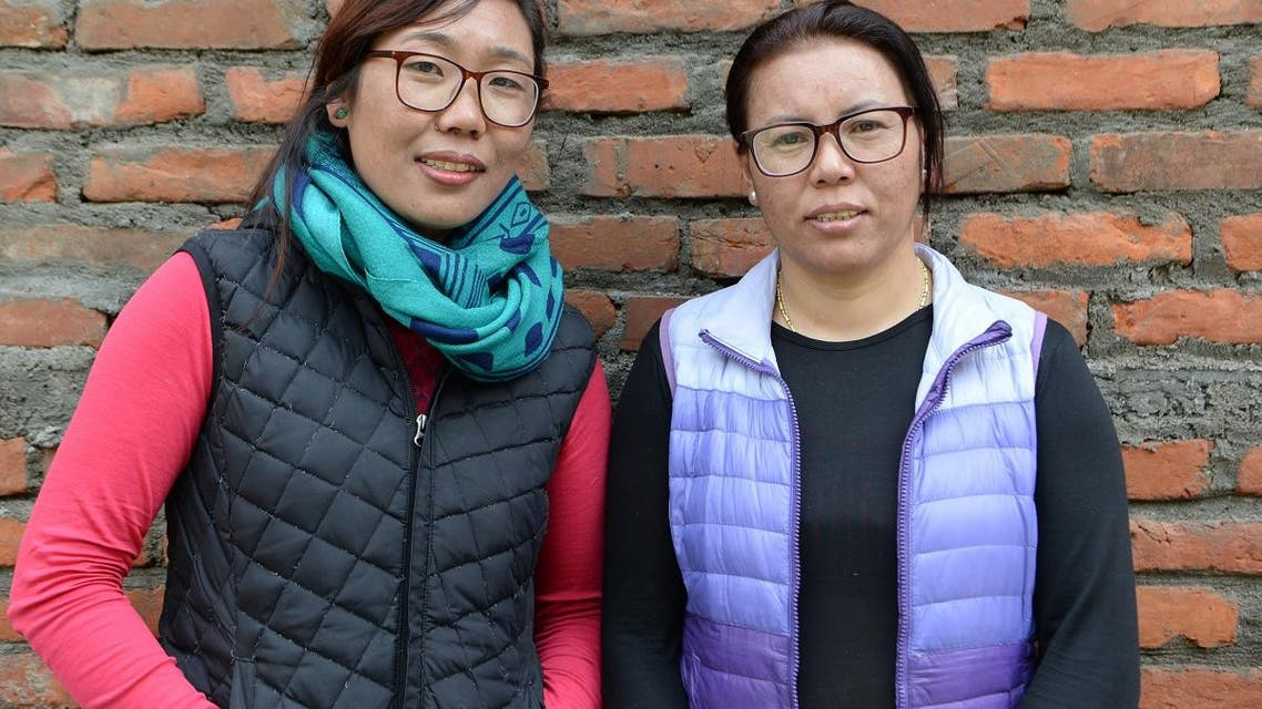 Furdiki Sherpa (R) and Nima Doma Sherpa (L), the Nepali widows of mountaineers, pose for a photo in Kathmandu. (AFP)