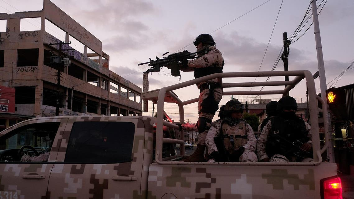 Mexican soldiers leave the scene of a crime where a man was killed by gun fire. (File photo: AFP)