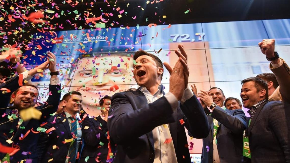 Ukrainian comedian and presidential candidate Volodymyr Zelensky reacts after the announcement of the first exit poll results in the second round of Ukraine's presidential election. (AFP)