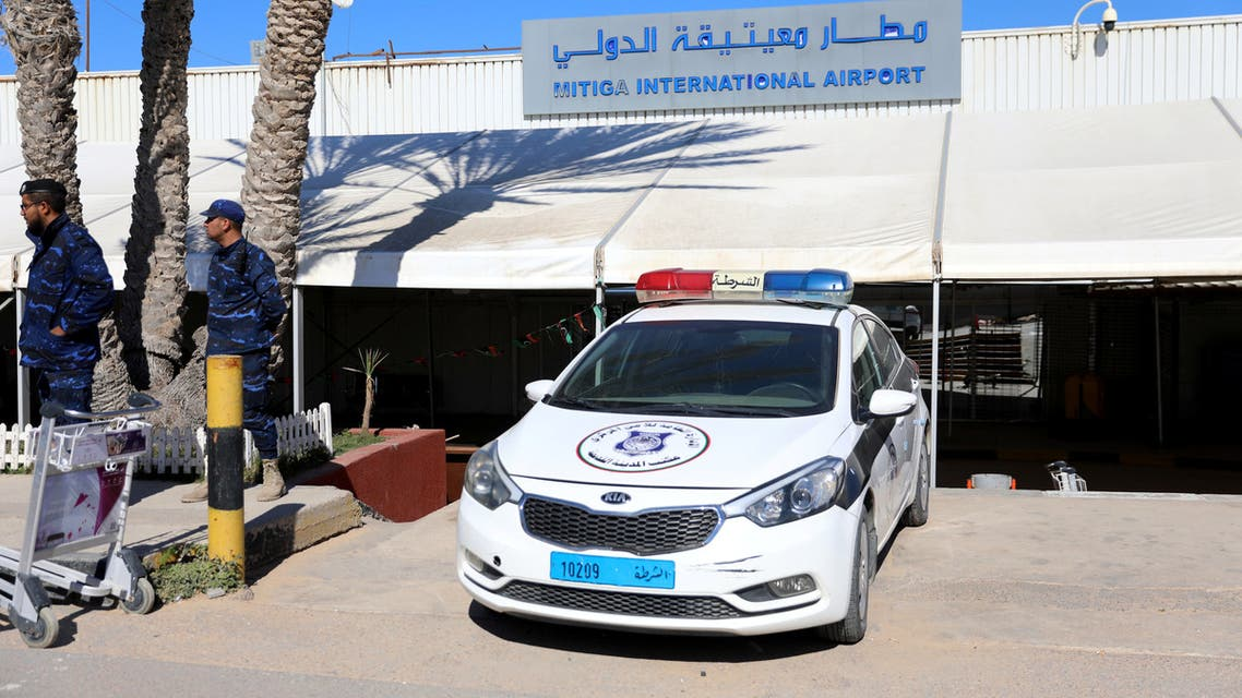 A police car is seen at Mitiga airport after an air strike in Tripoli, Libya April 8, 2019. REUTERS/Hani Amara
