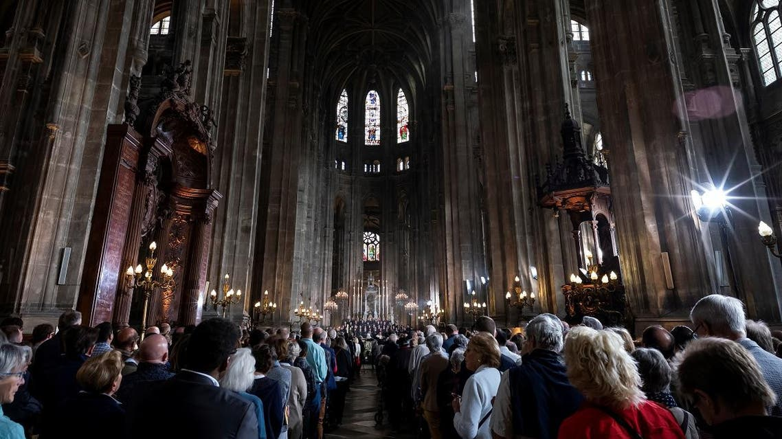 People attend Mass in tribute to the Notre-Dame de Paris Cathedral at the Saint Eustache church in Paris on Easter Sunday. (AFP)