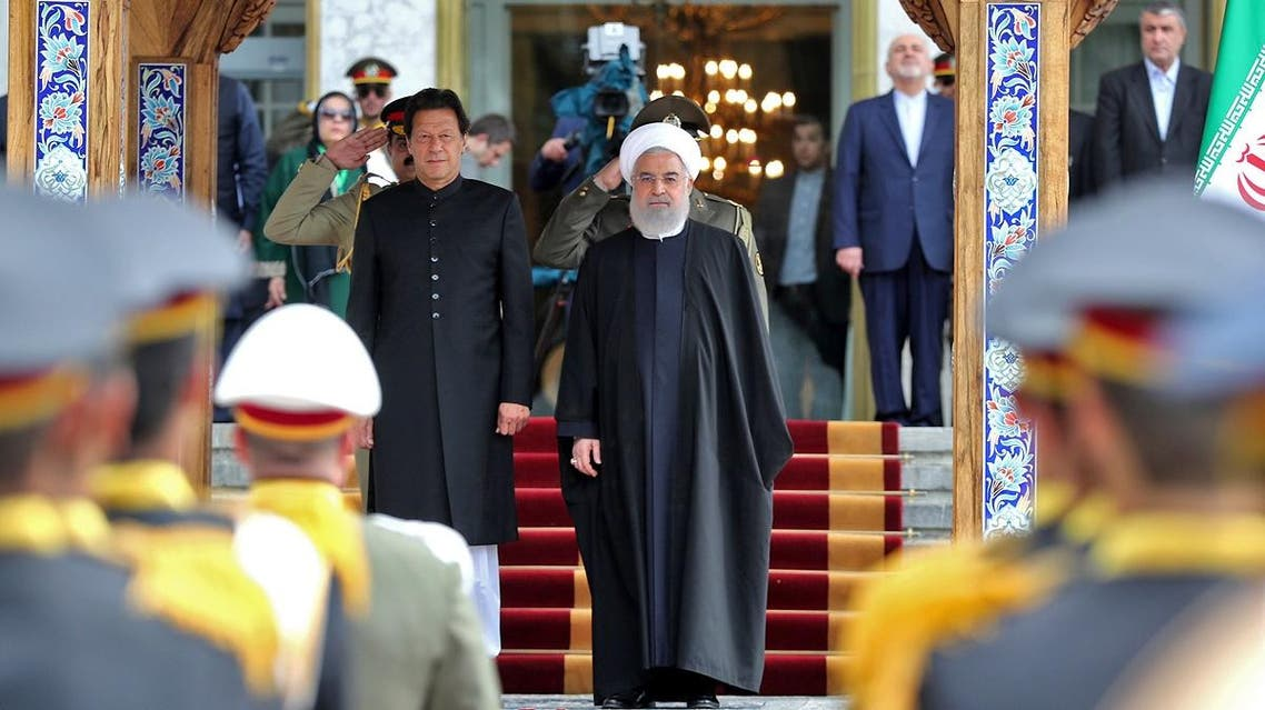 Iranian President Hassan Rouhani (R) and Pakistani Prime Minister Imran Khan, standing to the national anthem in the Iranian capital Tehran. (AFP)