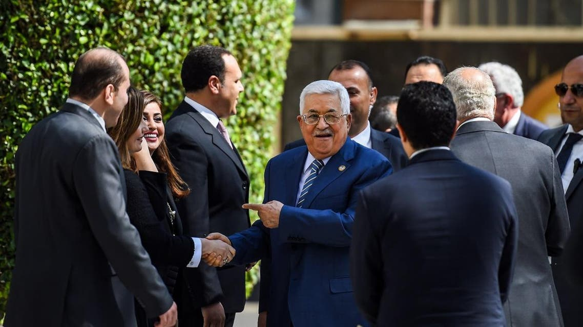 Palestinian president Mahmoud Abbas (C) is greeted upon his arrival at the Arab League headquarters in the Egyptian capital Cairo, to discuss the latest developments in the Palestinian territories on April 21, 2019.