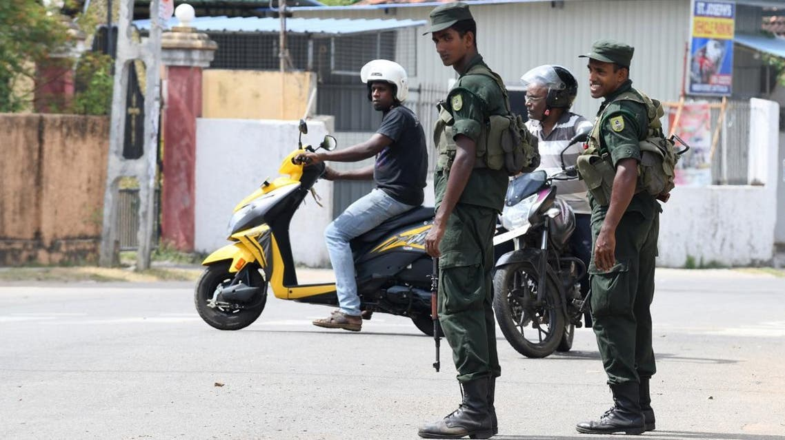 Sri Lankan soldiers stand guard on a street in Batticaloa in eastern Sri Lanka on April 21, 2019. (AFP)