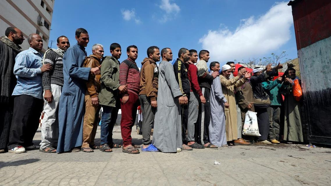 People stand in line to cast their vote during the referendum on draft constitutional amendments. (Reuters)