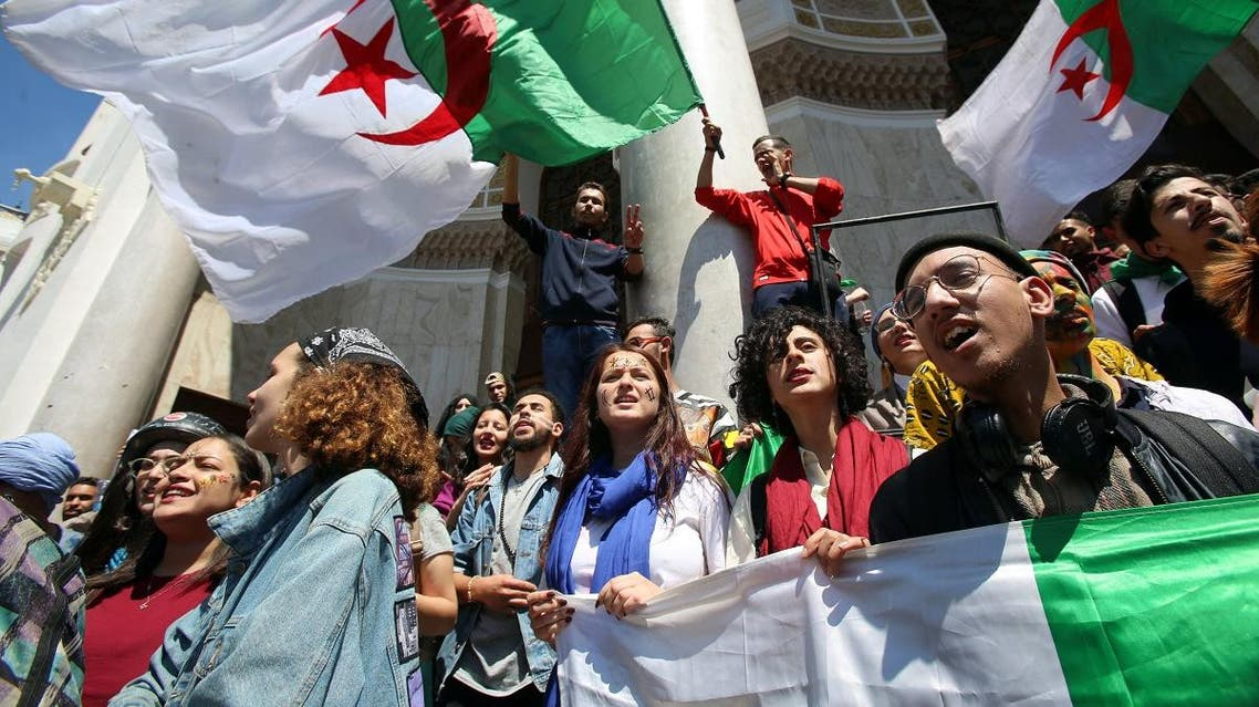 Demonstrators hold flag during anti government protests in Algiers. (Reuters)