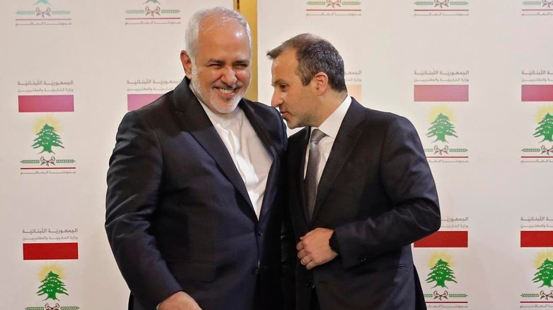 Lebanese Foreign Minister Gebran Bassil (R) speaks with his Iranian counterpart Mohammad Javad Zarif. (File photo: AFP)