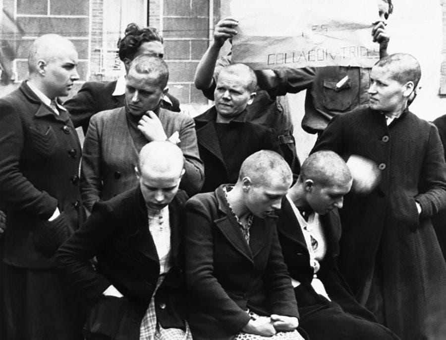 صورة لسبع نساء فرنسيات متهمات بالخيانة عقب حلق رؤوسهن