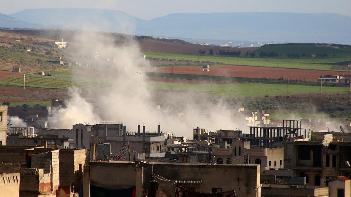 Smoke rises above building reported shelling in the town of Khan Sheikhun in the southern countryside of the rebel-held Idlib province. (AFP)