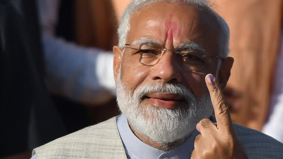 Indian Prime Minister Narendra Modi displays his ink-marked finger after casting his vote during the third phase of general elections at a polling station in Ahmedabad on April 23, 2019. (AFP)