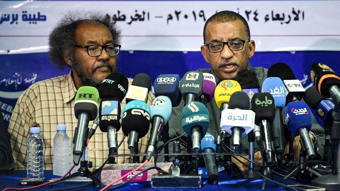 Sudanese civil society activists Muawia Shaddad (L) and Omar el-Digeir (R), two of the leaders from the Alliance for Freedom and Change movement, give a press conference in Khartoum. (File photo: AFP)