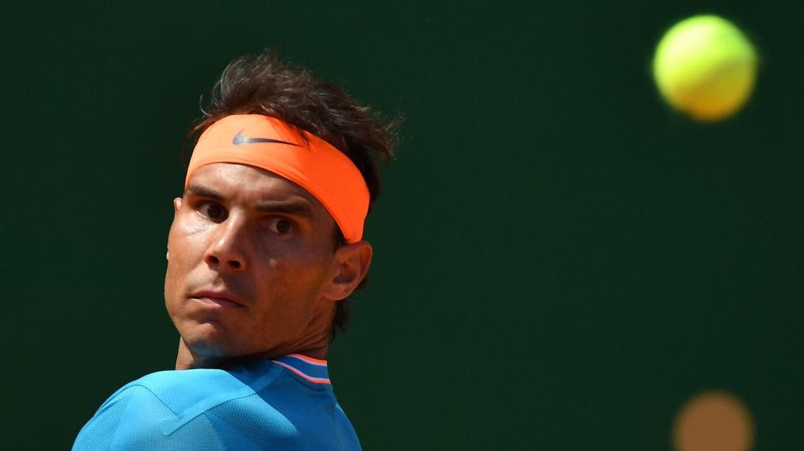 Spain's Rafael Nadal eyes the ball against Bulgaria's Grigor Dimitrov during their tennis match on the day 6 of the Monte-Carlo ATP Masters Series tournament in Monaco on April 18, 2019. (AFP)