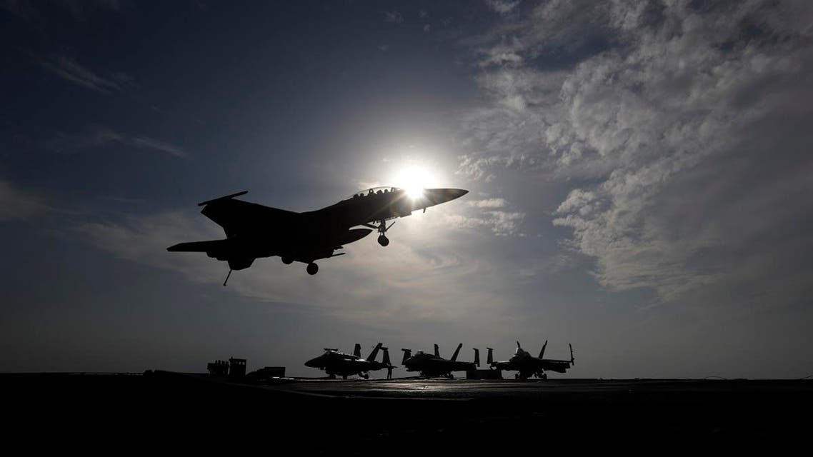 A U.S. Navy fighter jet lands on the deck of the U.S.S. Dwight D. Eisenhower aircraft carrier. (File photo: AP)