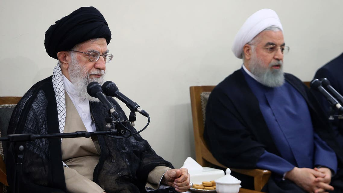 A handout picture provided by the office of Iran's supreme leader Ayatollah Ali Khamenei on August 29, 2018, shows Khamenei (L) speaking during a government meeting in the capital Tehran. To his right is Iran's president Hassan Rouhani. Iran's parliament declared its dissatisfaction with President Hassan Rouhani yesterday, voting to reject his answers after grilling him over the deteriorating economy.