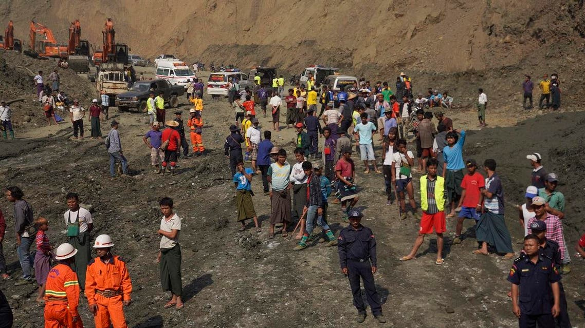 Search and rescue personnel and locals gather at a jade mine following a landslide in Hpakant, Kachin state, on April 23, 2019. (AFP)