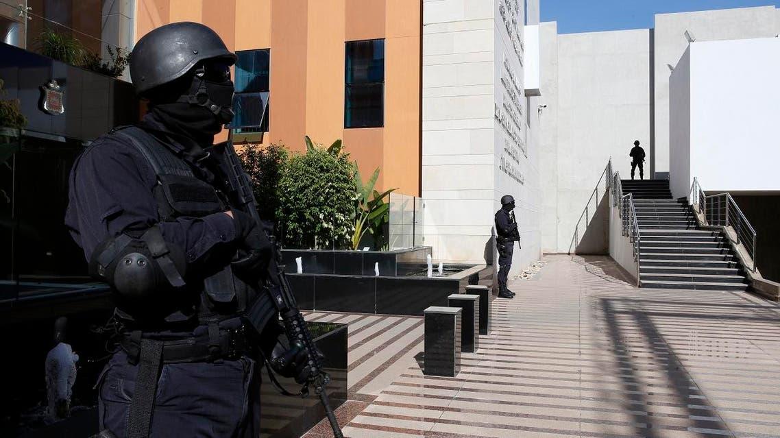 Moroccan special anti-terror units guards walk inside the Central Bureau of Judicial Investigations headquarters in Sale, near Rabat. (AP)