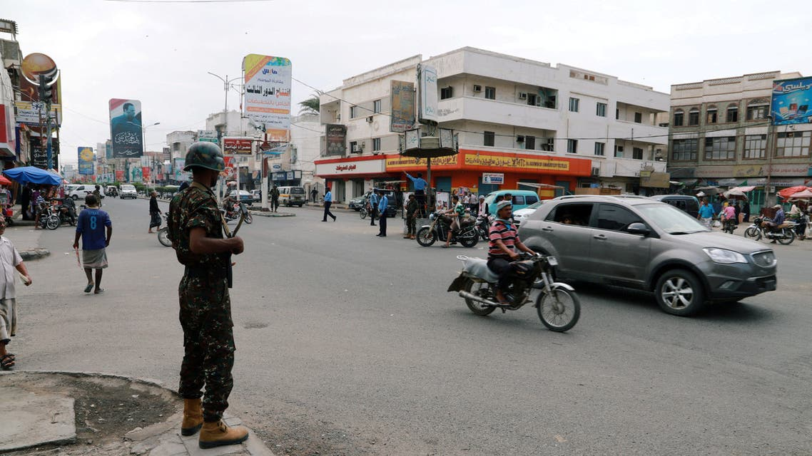 FILE PHOTO: A police trooper stands guard on a street in the Red Sea port city of Hodeidah, Yemen, February 13, 2019. REUTERS/Abduljabbar Zeyad/File Photo