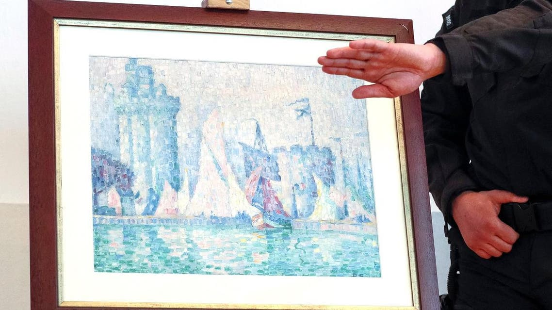 Officials attend a news conference dedicated to returning the painting by Impressionist Paul Signac to France, in Kiev. (Reuters)