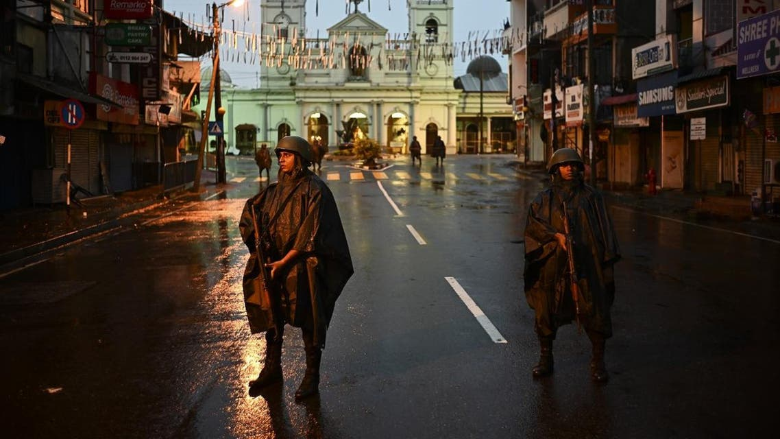 Sri Lankan soldiers stand guard under the rain at St. Anthony's Shrine in Colombo on April 25, 2019. (AFP)
