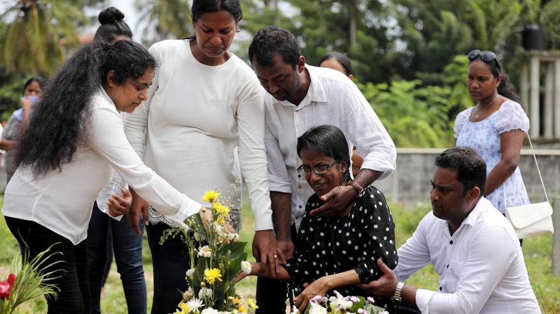 Family members mourn for their mother, a victim of the suicide attacks on churches and luxury hotels, at the site of a mass burial in Negombo, Sri Lanka, on April 25, 2019. (Reuters)